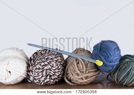 Close Up Of Threads For Knitting And Spokes On On Wooden Table On White Background Copyspace.