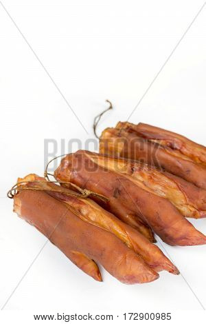 Smoked Pork Hooves Over White Background