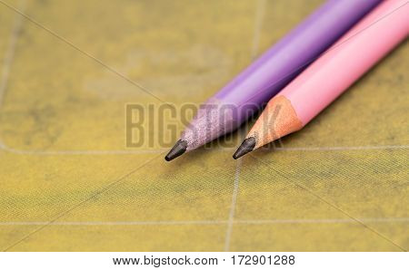 Calligraphy concept - pink and lilac pencils