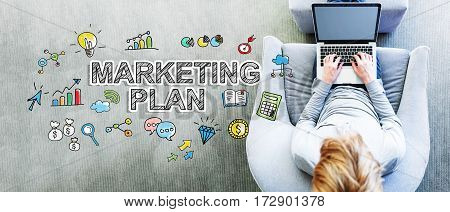 Marketing Plan Text With Man Using A Laptop