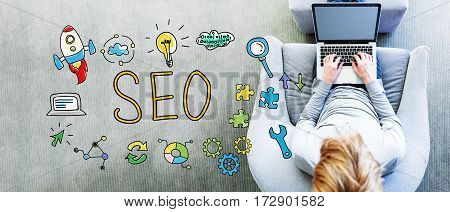 Seo Text With Man Using A Laptop