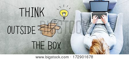 Think Outside The Box Text With Man Using A Laptop