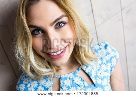 Close-up of beautiful smiling woman posing against texture background