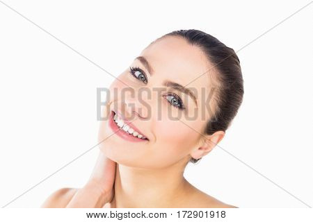 Close-up of beautiful woman smiling against white background
