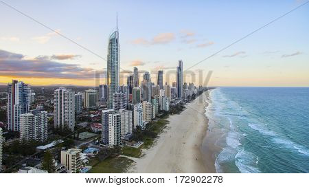Aerial view of sunset over Surfers Paradise and beach with Q1 and Soul buildings. Gold Coast Australia
