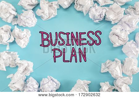 Business Plan Text With Crumpled Paper Balls