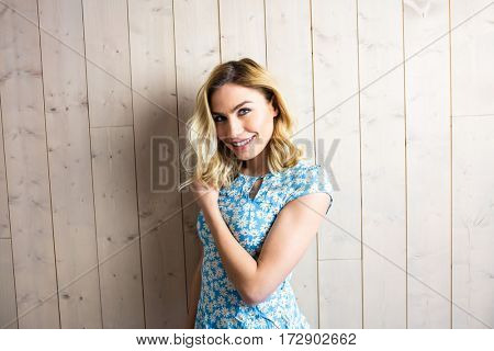 Portrait of smiling woman posing against texture background