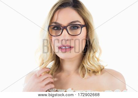 Close-up of beautiful woman with spectacles against white background