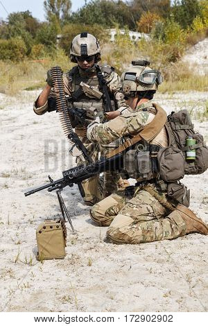 Members of US Army Rangers machinegun crew during the fight in the desert