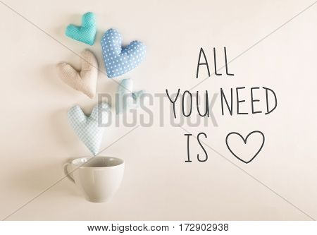All You Need Is Love Message With Blue Heart Cushions