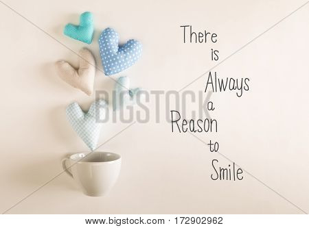 There Is Always A Reason To Smile Message With Blue Heart Cushions