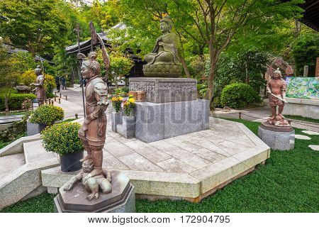 KAMAKURA, JAPAN - NOVEMBER 10, 2016: Buddist statues of Hase-dera temple in Kamakura, Japan. Hase-dera Buddhist temple is famous for housing