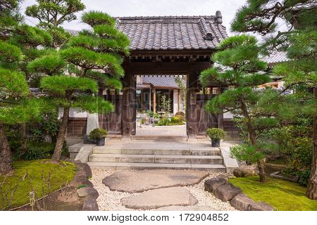 KAMAKURA, JAPAN - NOVEMBER 10, 2016: Gate to the garden of Hase-dera temple in Kamakura, Japan. Hase-dera Buddhist temple is famous for housing a massive wooden statue of Kannon.