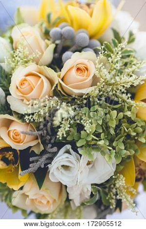Beautiful wedding bouquet from spring flowers close up. flower composition of pastel tones