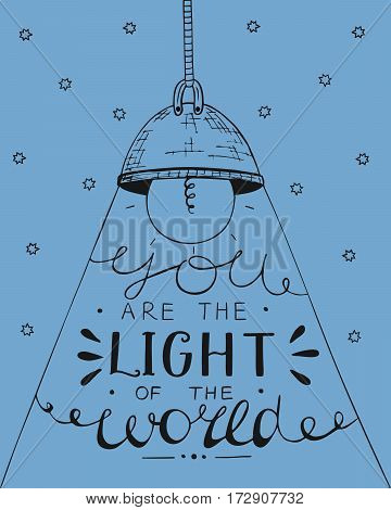 Hand lettering You the light of the world, made on the star background with glowing light bulb. Biblical background. Christian poster. New Testament