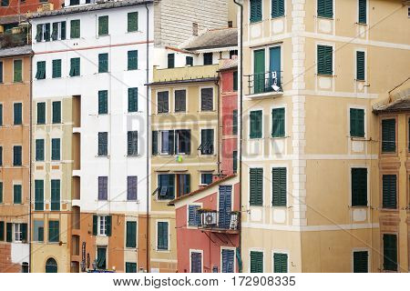 View of the typical pastel-coloured houses of Camogli, along the shores of Ligurian Sea (Northern Italy). Color image.