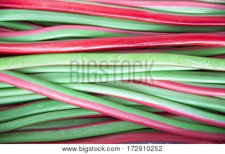 Homemade twisted colorful twisted licorice candies as a background