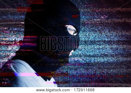 hacker portraite on the background noise glitch effect it stealing information attack