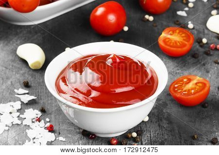 Tomato Sauce In White Bowl, Spice And Cherry Tomatoes On A Dark Background