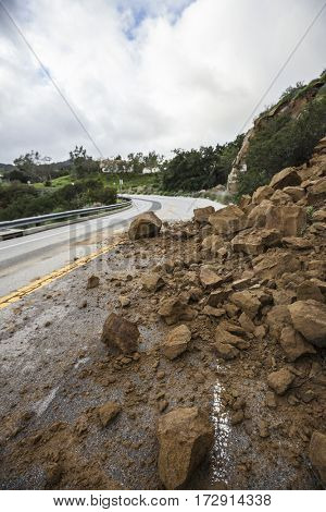 Storm damage rocks blocking Santa Susana Pass road in the San Fernando Valley area of Los Angeles, California.