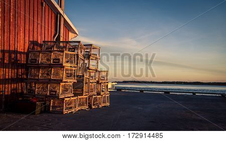 Stack of lobster traps at a wharf in pei
