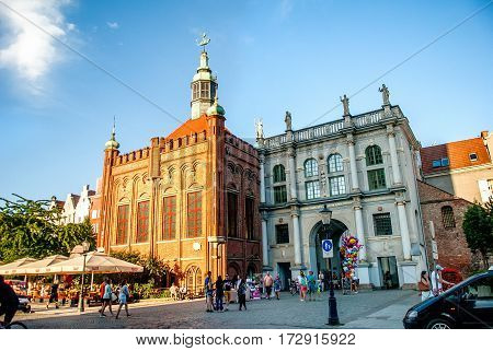 Gdansk Poland - July 18 2014:: Golden gate and St George Manor in the old city center. The most visited tourist destinations.