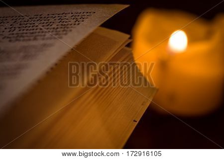 a book pages illuminated by old candle
