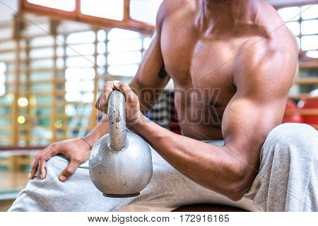 African american sports man body builder lifting heavy weight dumbbell at gym fitness center close up image of biceps training - Powerful attractive black guy exercising arms -