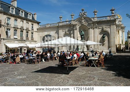 People Eating And Drinking In A Restaurant Of Nancy