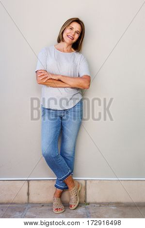 Attractive Senior Woman Smiling With Arms Crossed