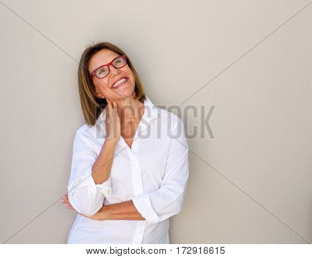 Smiling Business Woman With Glasses Looking Up