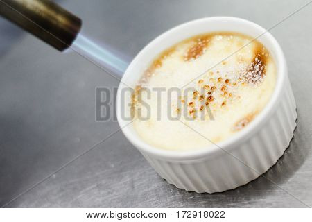 Burn Portion Of Creme Brulee Dessert