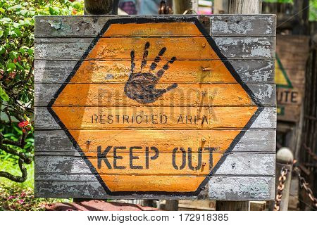Restricted area sign. Keep out. Warning. No entry. Old wooden painted board.