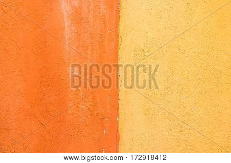 Close-up Yellow And Orange Color Concrete Wall Background. Texture Background.
