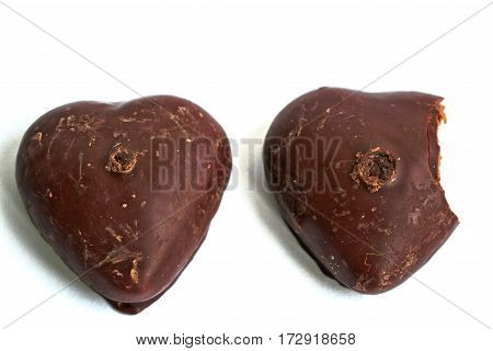 Chocolate covered gingerbread hearts on a white background