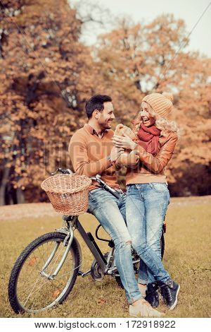 Young couple having a bike ride in nature.