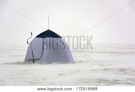 tent blue and white colors ice screws when ice fishing drill snow winter sea Gulf horizon