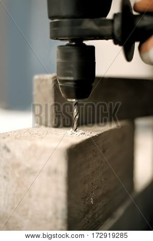 Electric Drill Drilling A Hole In Timber