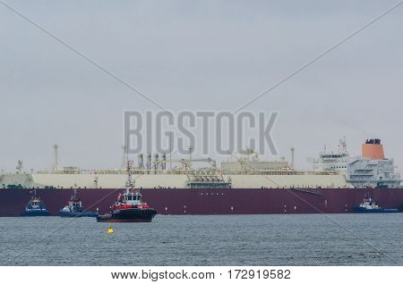 LNG TANKER -  Gas carrier supported by a tug during a maneuver to berth quay in Swinoujscie (Poland)