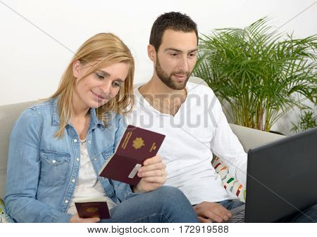 a young couple preparing vacation trip with passport