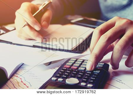 Close Up Hand Man Doing Finance And Calculate About Cost With Thinking Problem.