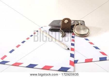 Notebook envelope pencil and pocket old watch