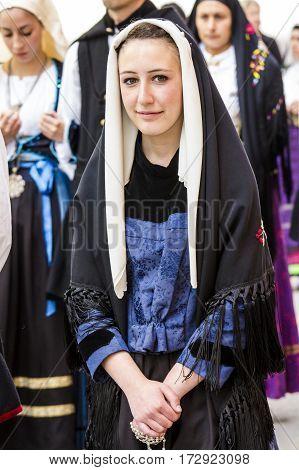 CAGLIARI, ITALY - May 1, 2016: 360 Feast of Saint Efisio - Sardinia - portrait of a beautiful girl in traditional Sardinian costume
