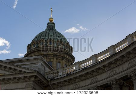 dome with cross of the Orthodox Kazan Cathedral on blue sky background Sunny day Saint Petersburg
