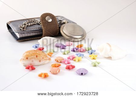 notebook old clock white seashells beads isolated