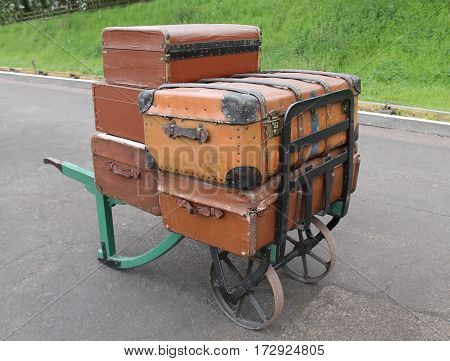 Old Suitcases on a Vintage Railway Luggage Trolley.