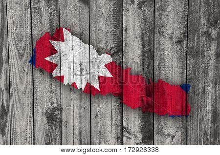 Map And Flag Of Nepal On Weathered Wood