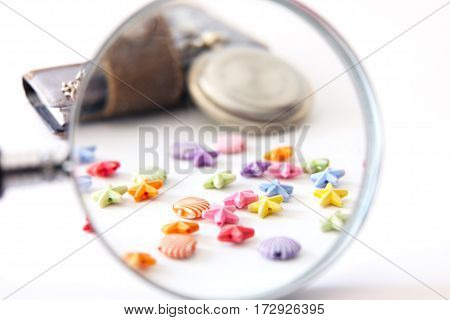 multi-colored beads magnifier old clock notebook isolated