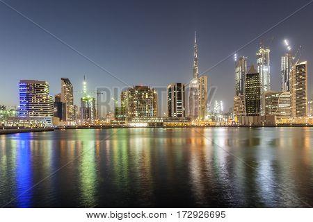 Skyline of the Dubai Business Bay district illuminated at night. United Arab Emirates Middle East