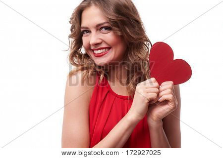 Close-up of exhilarated woman holding a valentine greeting card in hands isolated over white background. Lovely girl smiling at the camera